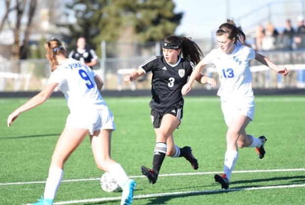 Jefferson Academy sophomore Mira Houck gains possession against Peak to Peak on April 5. The Jaguars are the No. 1 seed in the Class 3A state tournament.