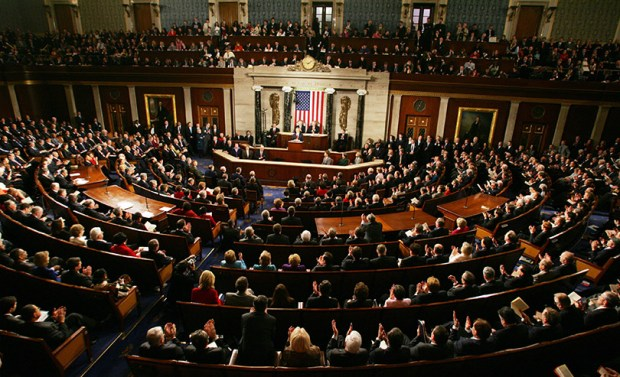 A joint session of Congress -- with Democrats and Republicans seated on opposite sides of the floor of the U.S. Capitol -- watches as President George W. Bush delivers his State of the Union address on Feb. 2, 2005.