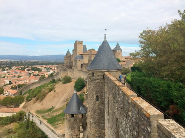 Visitors walk along the ramparts in the medieval city of Carcassonne.