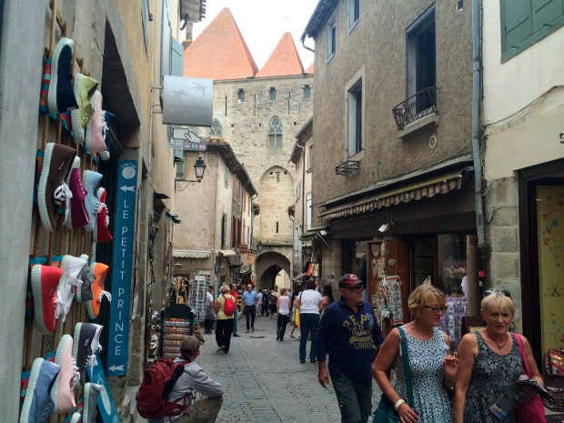 Visitors walk through a gauntlet of tourist shops in the medieval city of Carcassonne. Carcassonne is a castle-on-the-hill getaway in the south of France that sits somewhere at the intersection of fantasy and history.