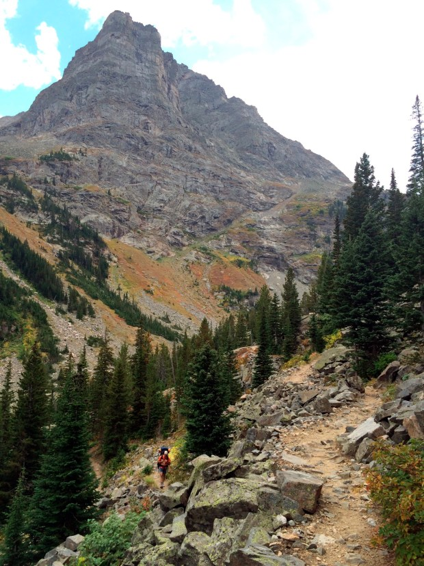 Mike Eckel climbs toward the watershed divide along the Beaten Path, a 26-mile hiking trail that crosses through Montana's Absaroka-Beartooth Wilderness.