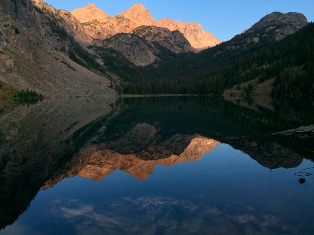 Pika Peak, shown at sunset, is mirrored in Echo Lake, one of scores that dot Montana's Absaroka-Beartooth Wilderness, making the region popular for hikers and anglers alike.