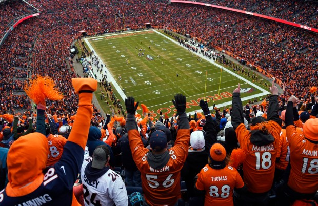 Broncos fans cheer during a playoff game on Jan. 24, 2016.