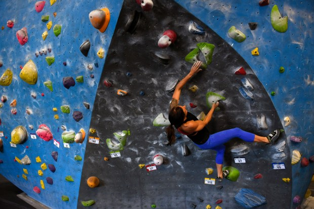 Karissa Gross boulders at Earth Treks Climbing gym on March 27, 2017 in Golden.