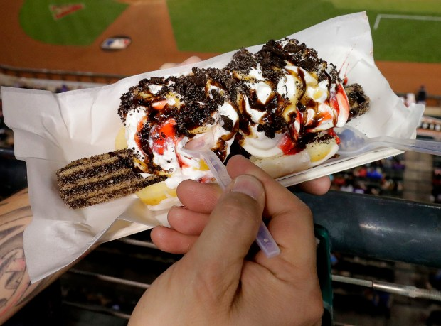 A fan holds the Churro Dog ...