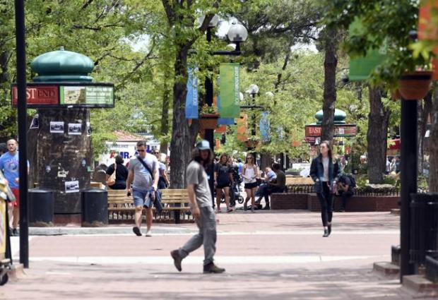 People walk on the Pearl Street Mall on Thursday in Boulder.