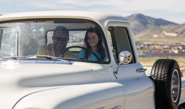 Haley Graham, 16, learns to drive a 1955 Chevy pickup with Joe Gonzales in Golden on May 13, 2017.
