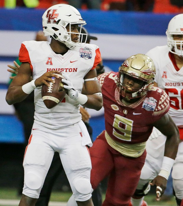Houston quarterback Greg Ward Jr. ...