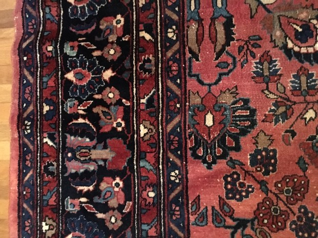 """""""After you use handmade rugs, you will never use machine-made again,"""" says the owner of this very fine salmon-colored Lilihan handmade rug from Persia (circa 1930-1940), who started decorating with machine-made rugs, then graduated to handmade rugs, and now has mostly hand-made antique Persian rugs."""