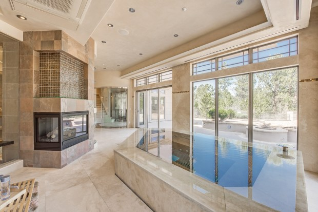 184 Morgan Place is an 8-bedroom, 11-bathroom modern mountain estate in Castle Pines Village -- with its own 10-car garage and private spa.