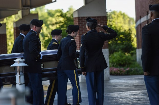Members of Bowie State University's ROTC program carry the casket of Richard Collins III into First Baptist Church of Glenarden in Upper Marlboro, Md.