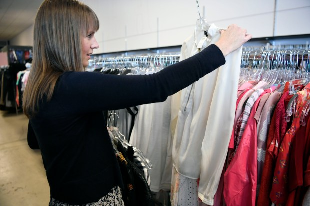 Mandy Anderson goes shopping at Peak Thrift store on May 23, 2017. Mandy picks out a few items to try on during her shopping excursion.