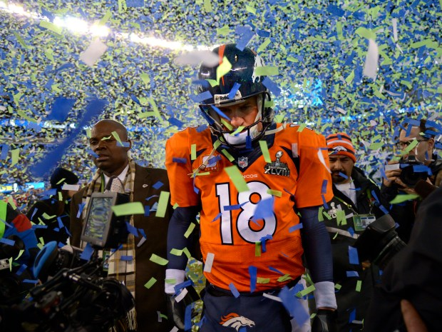Broncos quarterback Peyton Manning walks on the field after losing to the Seattle Seahawks in Super Bowl XLVIII on Feb. 2, 2014.
