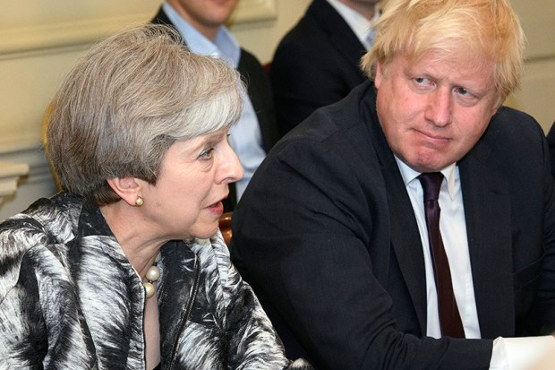 British Prime Minister Theresa May sits with Foreign Secretary Boris Johnson as she holds a Cabinet meeting on Monday. The Cabinet met for the first time Monday after a reshuffle by May following last week's general election.