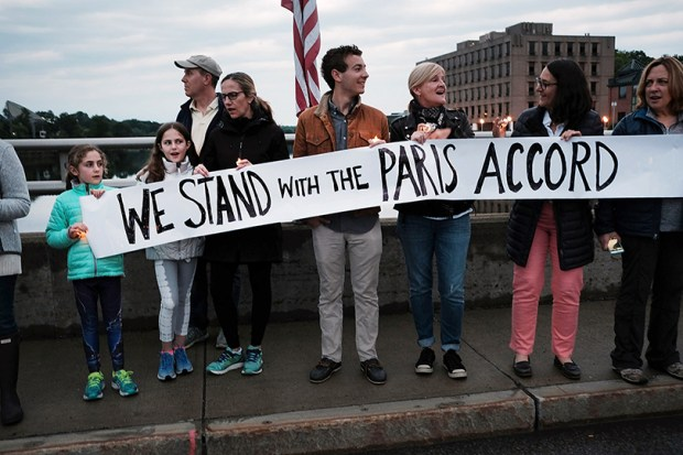 Connecticut residents show their support for the Paris climate agreement on Sunday in Westport, Conn., after President Donald Trump decided that the U.S. will pull out of the accord.