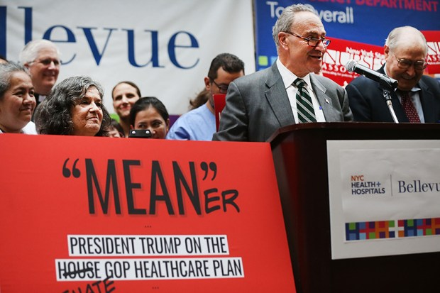 Senate Minority Leader Chuck Schumer speaks to doctors, nurses, patients and activists at Bellevue Hospital on Friday, the day after the Republicans released their health care bill to the public.