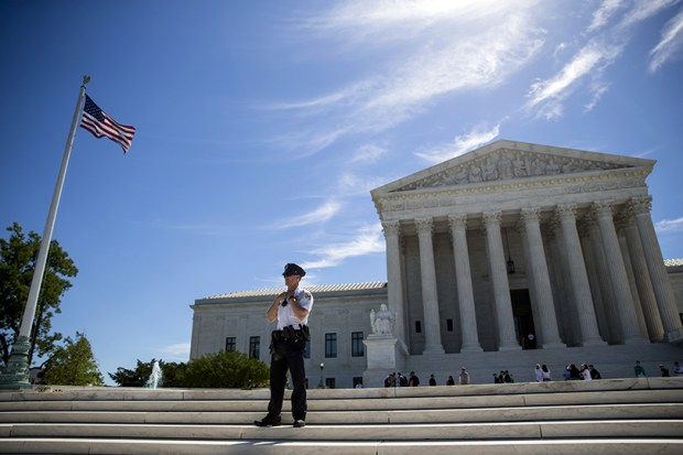 A police officer stands outside the U.S. Supreme Court on Monday.