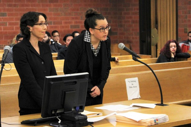 In this Tuesday, May 30, 2017 photo, University of Connecticut law professor Jessica Rubin, left, and UConn law student Taylor Hansen present arguments as animal advocates in a dog fighting case in Superior Court in Hartford, Conn.
