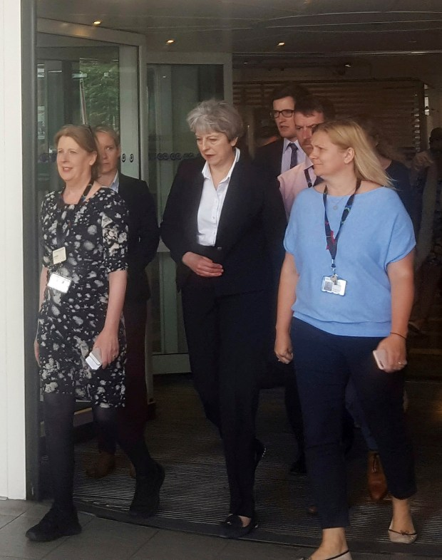 Britain's Prime Minister Theresa May, centre, ...