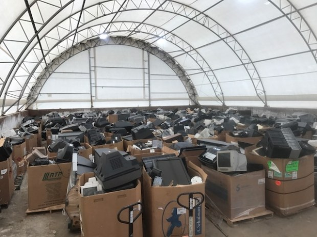 Hundreds of pallets of electronic waste had to be stored in City of Arvada facilities, including this salt storage dome, due to the overwhelming volume of drop-offs during the city's two-week recycling event.