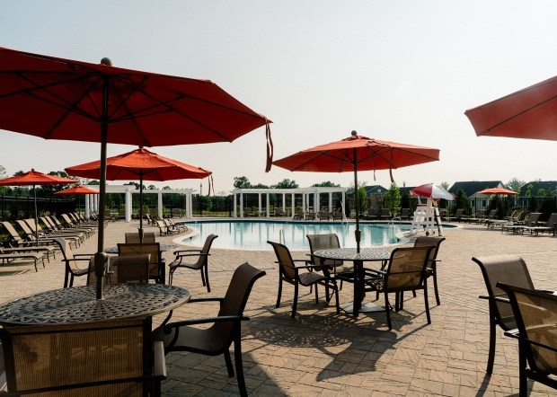 The outdoor pool and lounge area at Two Rivers in Odenton, Maryland. William Gerald, a vice president at the company that developed Two Rivers, says clubhouses for exercising and socializing are essential for senior-centered developments.
