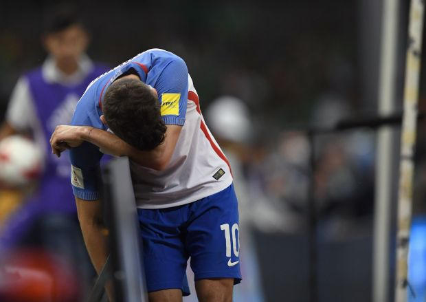 US player Christian Pulisic reacts after ...