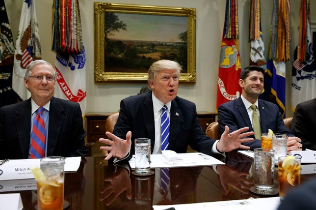 President Donald Trump, flanked by Senate Majority Leader Mitch McConnell of Ky., left, and House Speaker Paul Ryan of Wis., speaks during a March 1 meeting with House and Senate leadership in the Roosevelt Room of the White House.