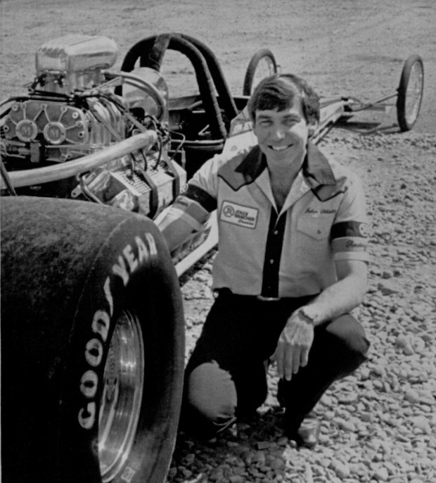 Denver drag racer Johnny Caywood Abbott Sr. poses for a picture next to one of his sleek rail racers in this Denver Post file photo.