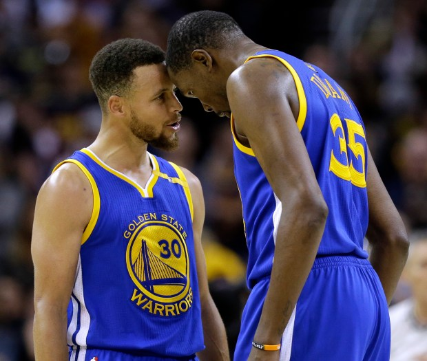 Golden State Warriors' Stephen Curry, left, ...