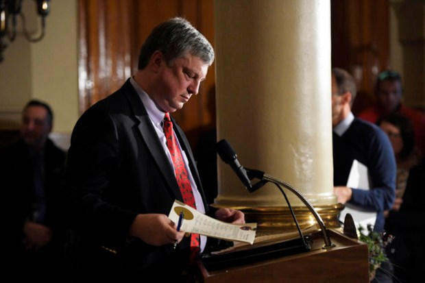 Colorado Secretary of State Wayne Williams checks signatures as he certifies the votes of the Colorado members of the Electoral College at the state Capitol on Dec. 19, 2016. Williams is backing a proposed policy change that would require Colorado presidential electors to take an oath swearing to back the winner of the state's popular vote or be replaced by someone who will.