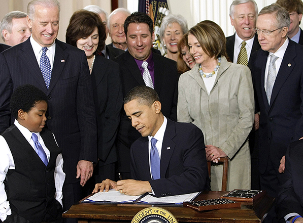 President Barack Obama signs the Affordable Care Act on March 23, 2010, at the White House.