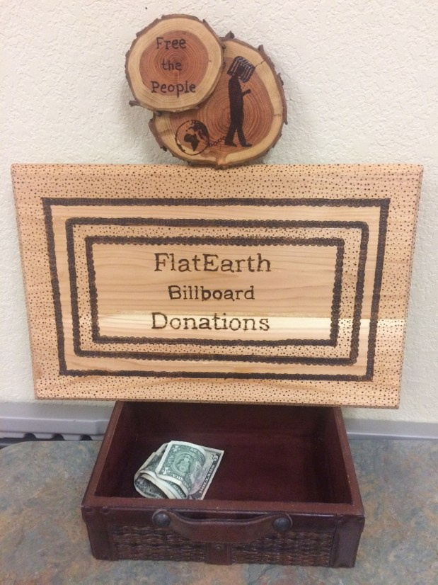 A collection box for billboard donations at a Tuesday meet-up.