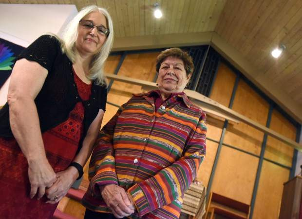 Elaine Schmidt, right, smiles as she stands next to Hollis Berendt on Friday at the Unitarian Church in Greeley. Elaine Schmidt is retiring from the Women's International League for Peace and Freedom after 44 years of service.