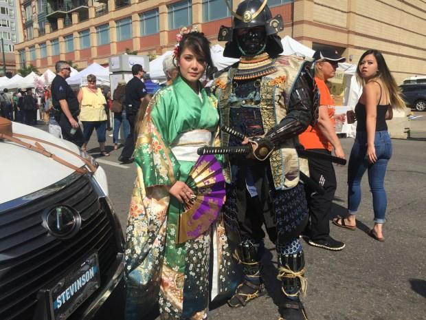 """Sage Asakawa, wearing a """"furisode,"""" or traditional kimono; and Kurt Weinreich, in Japanese samurai armor."""