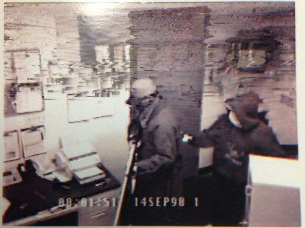 Rene Lima-Marin and Michael Clifton in an image from security video. Both were sentenced to 98 years in prison on charges related to a pair of 1998 video store robberies.