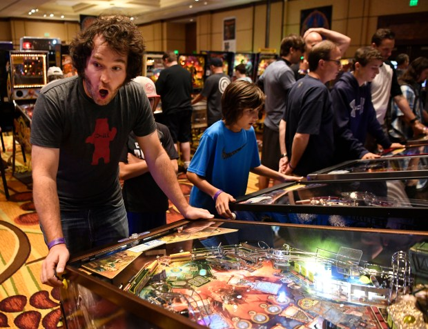 Pinball enthusiast David Scheid, left, reacts ...