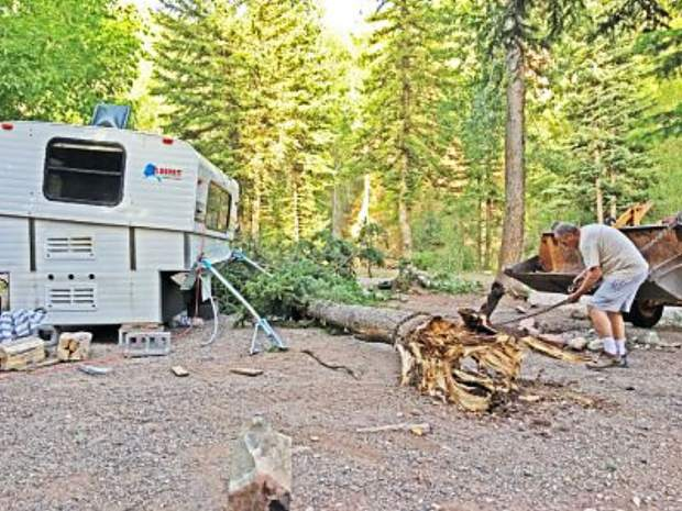 This camper trailer barely withstood the impact of a tree felled by strong winds Monday at a New Castle campground.