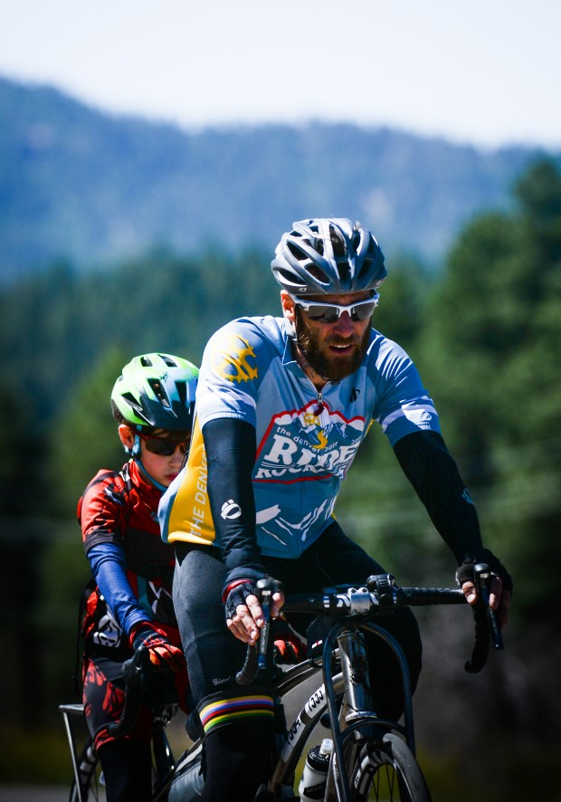 Jason Timmons and his son, Logan, ride Day 2 of Ride the Rockies between Pagosa Springs and Durango on June 12, 2017