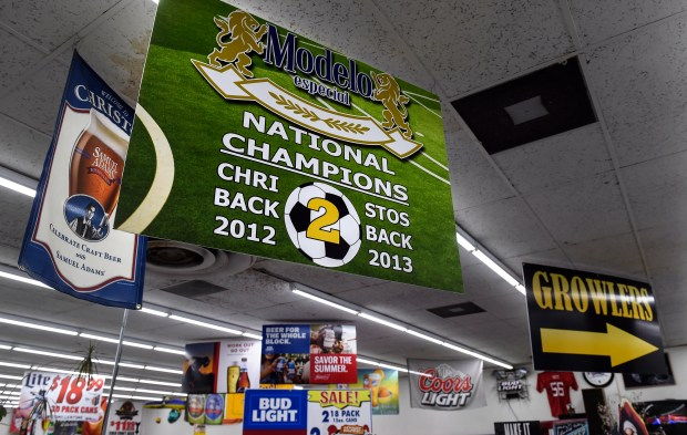 A sign advertising beer also honors the Christos FC soccer team. MUST CREDIT: Washington Post photo by Toni L. Sandys