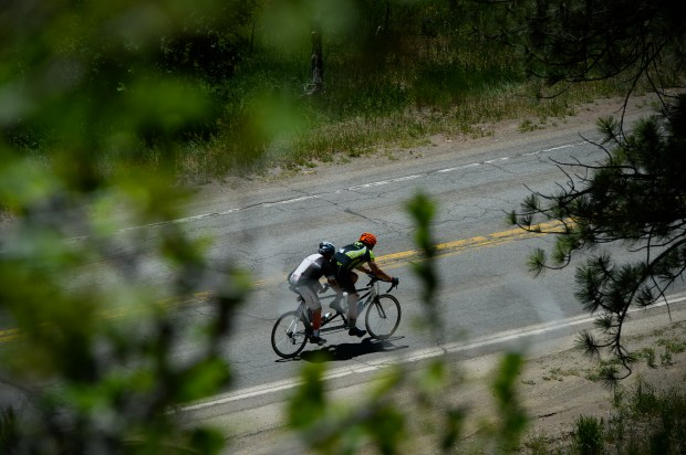 Riders descend on the route between ...