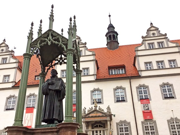 A statue of Martin Luther looks over Wittenberg's main Market Square. This year marks the 500th anniversary of Luther's public plea that triggered the Protestant Reformation.