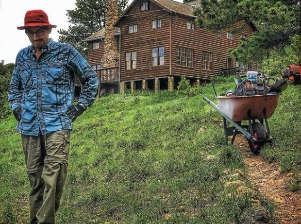 Glenn Fernandez helps with opening preparations on June 17 at Rocky Mountain Ecodharma Retreat Center.