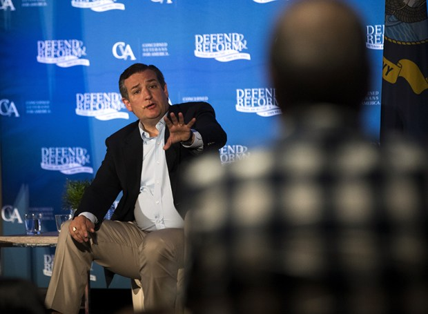 Sen. Ted Cruz, R-Texas, discusses health care issues with citizens during a town hall meeting in Austin on Thursday.