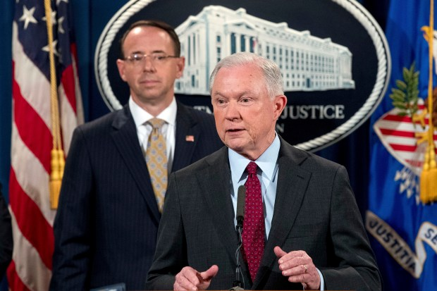 Attorney General Jeff Sessions, accompanied by Deputy Attorney General Rod Rosenstein, speaks at a news conference Thursday at the Department of Justice.