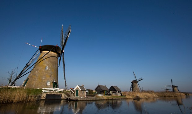 Windmills line Hooge Boezem van de Nederwaard canal at the Unesco World Heritage site in Kinderdijk, Netherlands.