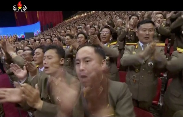 This image made from undated video of a news bulletin aired by North Korea's KRT on July 10, 2017, soldiers applaud North Korea's leader Kim Jong Un in Pyongyang. Kim attended a concert replete with pop music and thunderous applause to fete the successful launch of his country's first intercontinental ballistic missile. Independent journalists were not given access to cover the event depicted in this photo. (KRT via AP Video)