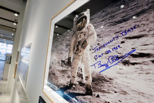 "A print of astronaut Neil Armstrong's photograph of fellow Apollo 11 astronaut ""Buzz"" Aldrin standing on the moon, to be offered at auction at Sotheby's, is displayed in New York, Thursday, July 13, 2017. The photo, autographed by Aldrin, is estimated at $2,500 to $3,500."
