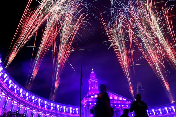 Fireworks explode over the Denver City and County building during Independence Eve celebrations at Civic Center on July 3, 2016. Personal fireworks displays are prohibited in the city and county of Denver.