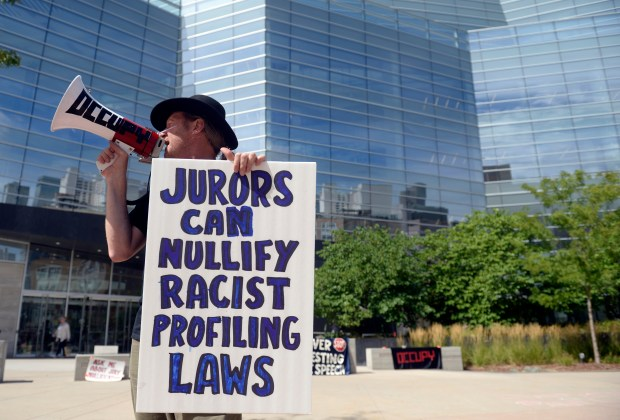 Occupy Denver protester Eric Verlo uses a bullhorn to speak out on jury nullification at the Lindsey-Flanigan Plaza in front of Denver's courthouse on Aug. 31, 2015.
