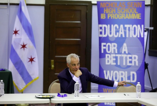 Chicago Mayor Rahm Emanuel listens to students talks about their high school experiences at Senn High School.